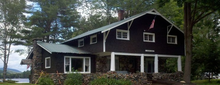 Stone Lodge on Loon Lake - view of front of house with lake in background