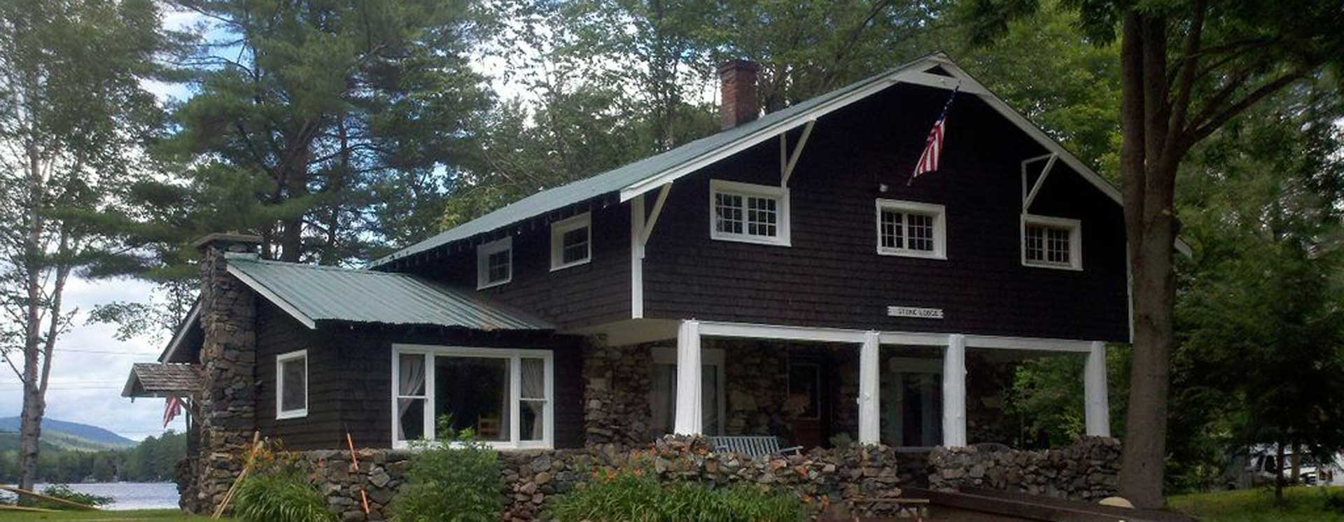 Stone Lodge on Loon Lake, front of house with lake in background